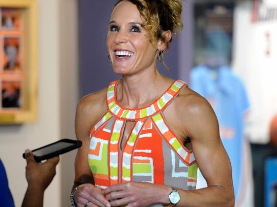FILE - In this June 10, 2016, file photo, former WNBA player Jackie Stiles is interviewed before an induction ceremony into the Women's Basketball Hall of Fame in Knoxville, Tenn. The farming town of Claflin, Kan., is helping raise money for Stiles as she prepares for surgery Friday, Feb. 2, 2018, to treat her ocular melanoma. (Adam Lau/Knoxville News Sentinel via AP, File)