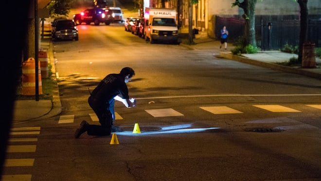 Wilmington Police investigate a shots fired scene at the intersection of North Madison and West 7th Streets Monday night.