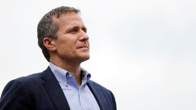Missouri Gov. Eric Greitens stands off to the side before stepping up to the podium to deliver remarks to a small group of supporters near the Capitol announcing the release of funds for the state's biodiesel program Thursday, May 17, 2018, in Jefferson City, Mo. (AP Photo/Jeff Roberson)