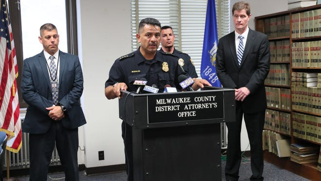 Milwaukee Police Chief Alfonso Morales (center), District Attorney John Chisholm (far right), police Capt. Paul Formolo (far left) and Chris Botsch (center right), deputy chief of the West Allis Police Department, announced the take-down of a drug ring.