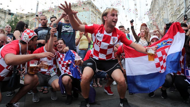 Croatia fans gather in Nikolskaya Street in the center of Moscow, 14 July 2018. Croatia will face France in the final of the FIFA World Cup 2018 on 15 July.