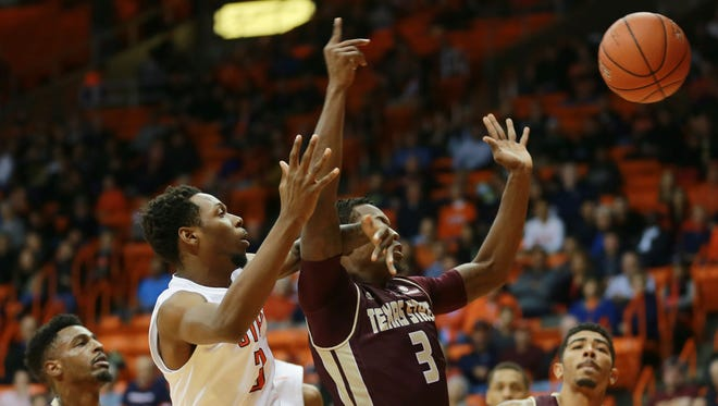 UTEP's Brodricks Jones battles Texas State's Cameron Naylor, left, Maljhum McCrea, center, and Bobby Conley for a rebound during a game last season at the Don Haskins Center.  Jones and Josh McSwiggan both announced they are transferring out of UTEP.
