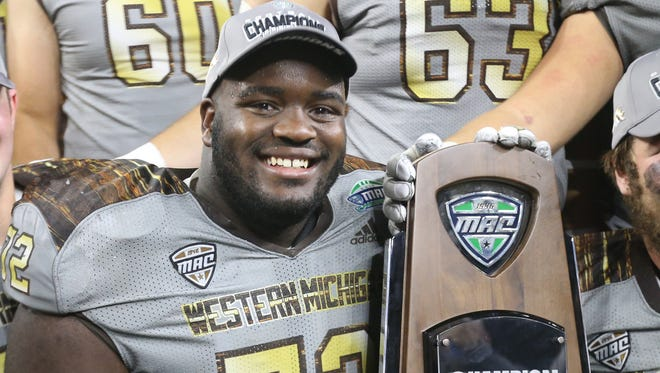 Western Michigan lineman Taylor Moton celebrates WMU's 29-23 win over Ohio in the MAC title game Friday at Ford Field.