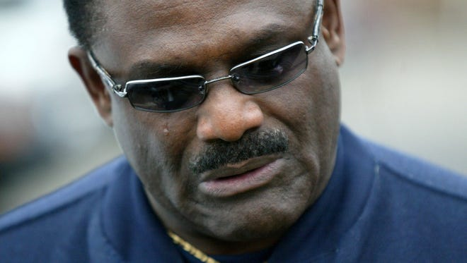 Former Michigan player Billy Taylor (#42) cries after hearing about the loss of former Michigan University football coach Bo Schembechler on Friday, Nov. 17, 2006 in Ann Arbor. Taylor was named to the All-American team three consecutive seasons.