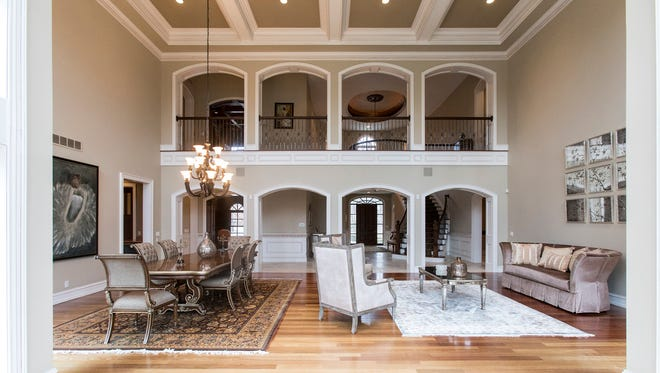The dramatic interior architecture includes this wall that's made by stacking two rows of arches, reminiscent of the ancient Roman aqueduct that spans a chasm in France. The coffered ceiling follows the design.