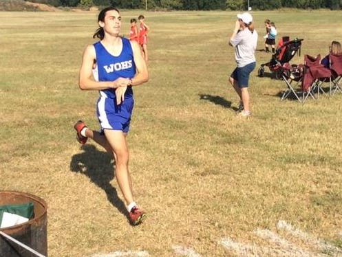 West Ouachita's Jansen Nowell crosses the finish line first at the Byrd Invitational on Saturday.