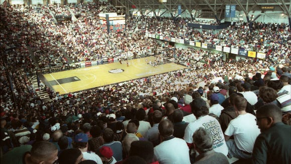 """""""NOT A SEAT TO BE FOUND: The crowd swelled beyond 11,000 as Ben Davis and Washington met in the Hinkle Regional"""" Saturday March 11, 1990. Washington's heart was broken by Ahmed Bellemy's 22-foot desperation shot for Ben Davis with 1.5 second left. Ben Davis beat Washington 79-77.  (Photo published on Sports front of The Sunday Star March 11,1990."""