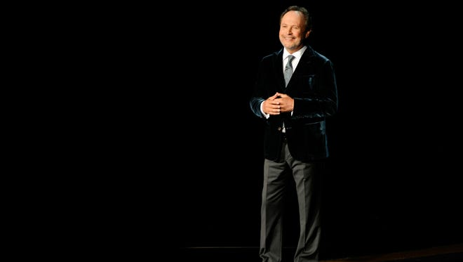 Billy Crystal speaks during an In Memoriam tribute to Robin Williams at the 66th Annual Primetime Emmy Awards on Monday night in Los Angeles.