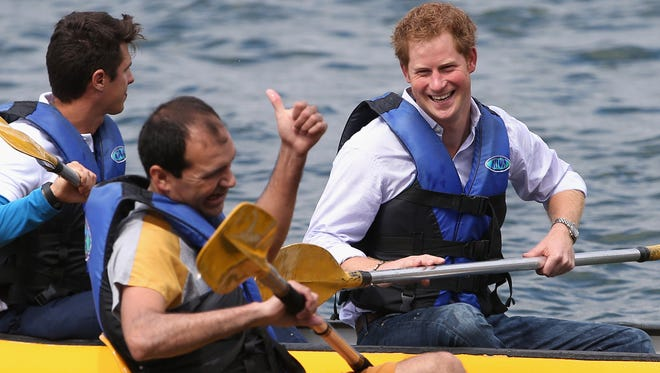 Prince Harry shares a joke with a patient from the Rede Sarah Hospital for Nerological Rehabilitation injuries as he takes part in a canoe therapy session on Lake Paranoa on June 23, 2014 in Brasilia, Brazil.