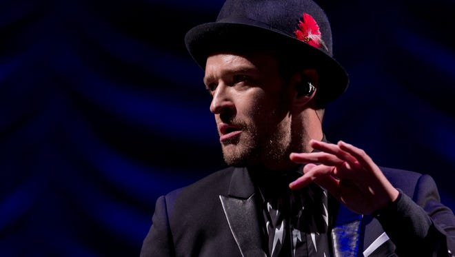 Justin Timberlake performs on the Virgin Media Stage during Day 1 of the V Festival at Hylands Park on August 16, 2014 in Chelmsford, England.
