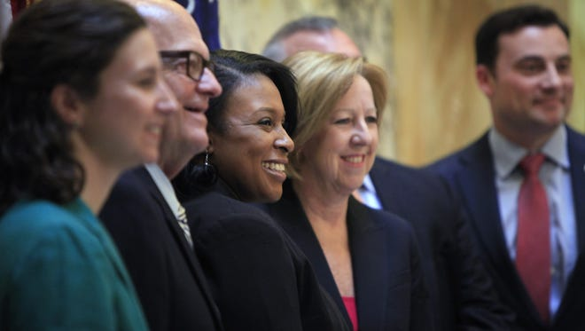 Smiling at the end of  a press conference in the County Office Building Atrium after discussing the CityGate project and efforts to bring the first Costco to Western New York are from left, Minority Leader Carrie Andrews, Anthony J. Costello â?? Chairman of The Costello Group, Rochester Mayor Lovely Warren, Monroe County Executive Maggie Brooks and Vincent Esposito, Executive Director of Empire State Developmentâ??s Finger Lakes Regional Office.