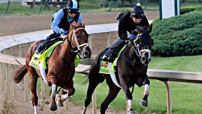 Kentucky Derby hopefuls Danza, left, and stablemate Vinceremos work in company for trainer Todd Pletcher at Churchill Downs on Sunday