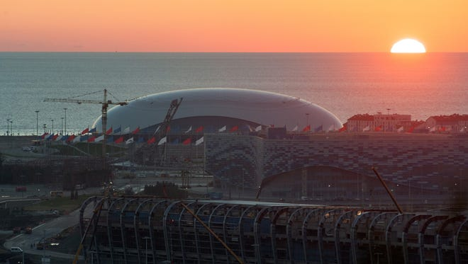 The Olympic Bolshoy stadium, in the background, is shown in the Olympic Park  in the Black Sea resort of Sochi, Russia, on Oct. 24, 2013.
