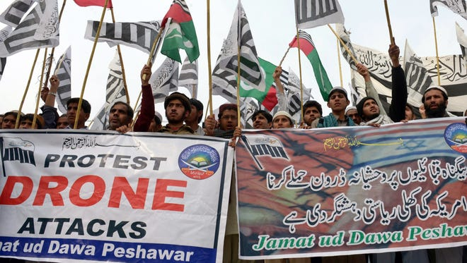 This photograph taken on Nov. 10, 2013, shows supporters of the Defense of Pakistan Council (DPC), a coalition of religious and political parties, shouting anti-U.S. slogans during a protest against drone strikes in Peshawar.