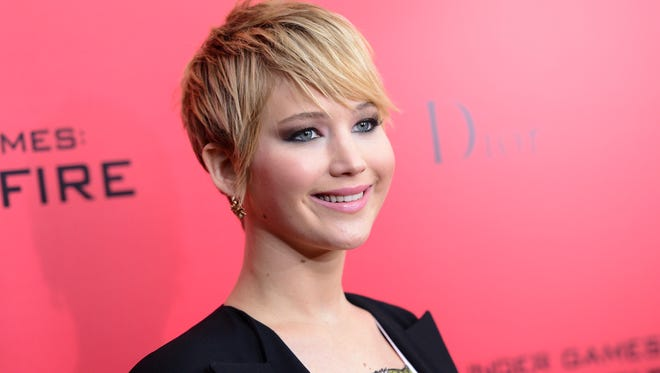 """Jennifer Lawrence sports a pixie haircut at a special screening of """"The Hunger Games: Catching Fire"""" in New York."""