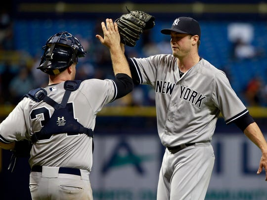 Andrew Miller, with catcher Brian McCann, recorded
