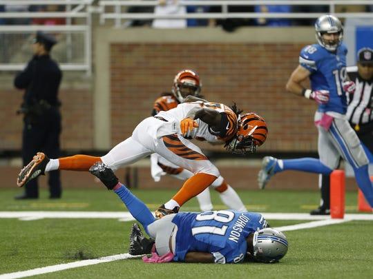 Detroit Lions wide receiver Calvin Johnson (81) crosses the goal line with a touchdown as Cincinnati Bengals cornerback Dre Kirkpatrick (27) defends in 2013.