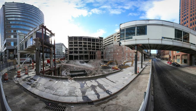 Panoramic image made from multiple photos of demolition work Tuesday Feb. 24, 2015, of the Younkers building since the March 29, 2014 fire that gutted the east portion of the building. The view is looking west from 7th street in downtown Des Moines