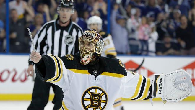 Boston Bruins goaltender Tuukka Rask tries to show the officials his broken skate blade.