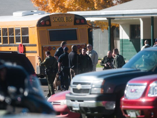 Law enforcement gather in the parking lot after the shooting on Oct. 21, 2013, at Sparks Middle School. Seventh-grade student Jose Reyes killed teacher Michael Landsberry and injured two students before killing himself in the worst instance of school violence in Northern Nevada history.
