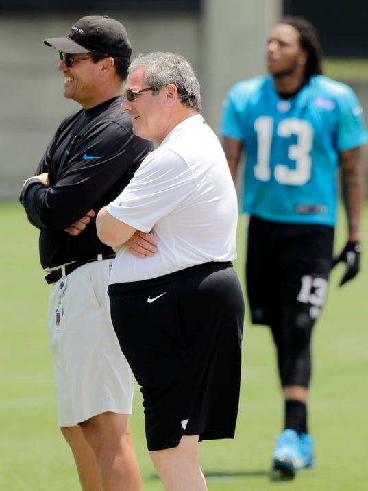 Carolina Panthers' head coach Ron Rivera, left, stands with general manager Dave Gettleman as their first pick, Kelvin Benjamin (13) returns from a pass route during an NFL football organized team activity in Charlotte, N.C., Wednesday, May 28, 2014. (AP Photo/Bob Leverone)