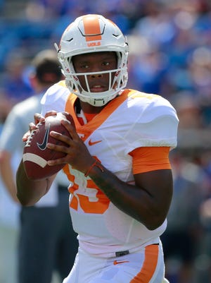 Tennessee Volunteers quarterback Sheriron Jones (13) works out prior to the game at Ben Hill Griffin Stadium.