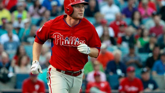 Phillies third baseman Cody Asche (25) hits a solo home run March 19 during the second inning against the New York Yankees at George M. Steinbrenner Field. Credit: Kim Klement-USA TODAY Sports