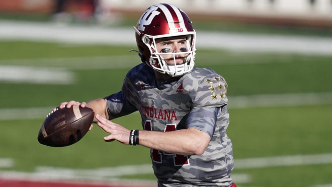 Indiana quarterback Jack Tuttle (14) throws during the second half of an NCAA college football game against Maryland, Saturday, Nov. 28, 2020, in Bloomington, Ind. Indiana won 27-11.
