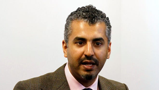 """FILE - In this June, 27, 2011, file photo, Maajid Nawaz, Executive Director of the Quilliam Foundation and formerly with the international Islamist Party Hizb ut-Tahrir, speaks to the media during a news conference at the Summit Against Violent Extremism in Dublin, Ireland. The Southern Poverty Law Center issued statement saying it was wrong to include the London-based Quilliam and Nawaz in a """"Field Guide to Anti-Muslim Extremists."""" Quilliam had threatened to sue, but an official says a settlement offer came before any suit was filed. (AP Photo/Peter Morrison, File)"""