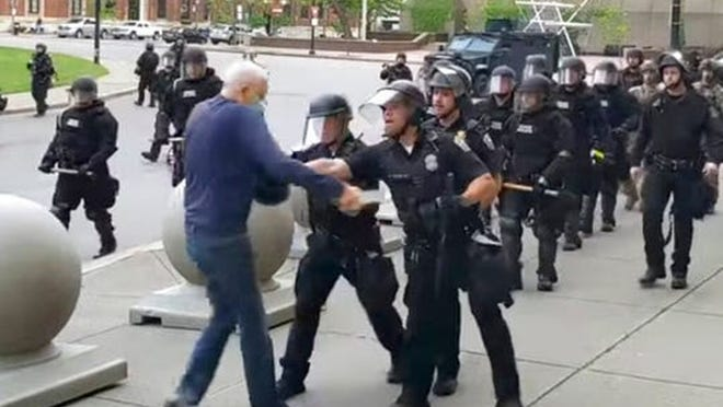 In this image from video by WBFO, a Buffalo police officer appears to shove a man who walked up to police Thursday, June 4,  in Buffalo.
