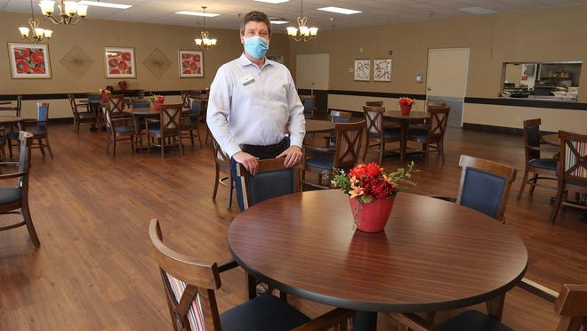 Max Agee, the administrator of Timberland Ridge Nursing & Rehabilitation in Copley, stands inside the facility's dining room Tuesday.