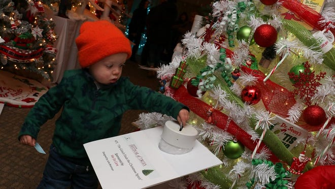 The Easton Festival of Trees will be held this year, but will be a virtual event. Above, Jared Cohenno, 2, adding a ticket to the Grinch Finds the Christmas Spirit tree during the 2019 Easton Festival of Trees.