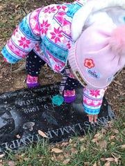 James Lamar Tamplin's daughter at his grave site. She