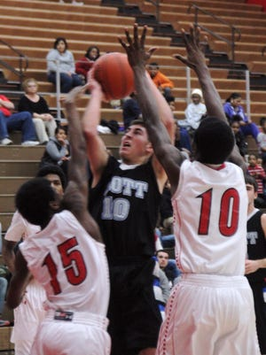 Scott's Blake Schneider, shooting the ball in a game against Holmes Feb. 3, returns to lead Scott in 2014.
