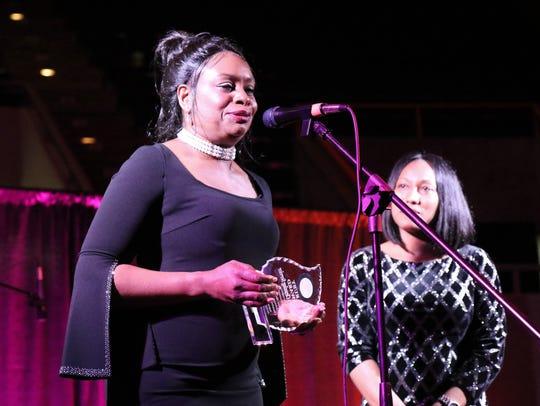 Carlida Watson accepts the Ruby Award on behalf of