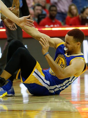 Warriors guard Stephen Curry sprained a knee ligament in Sunday's Game 4 victory against the Houston Rockets and won't return until the second round, at the earliest.