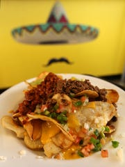 These are nachos from Tacoholics.