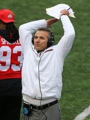 Ohio State coach Urban Meyer reacts to a play in overtime