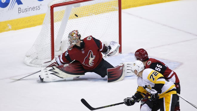 Pittsburgh Penguins defenseman Olli Maatta (3) scores a goal on Arizona Coyotes goalie Antti Raanta (32) during a NHL game at Gila River Arena in Glendale on December 16, 2017.