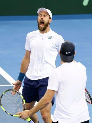 U.S. Steve Johnson, left, celebrates near teammate Jack Sock after winning in doubles against Australia's Sam Groth and John Peers at the Davis Cup quarterfinal.