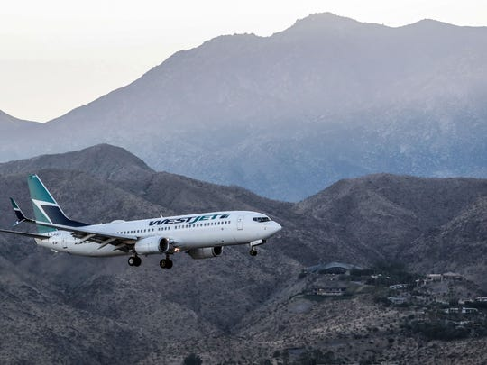 A West Jet flight lands in Palm Springs International Airport on Friday, December 165, 2017.