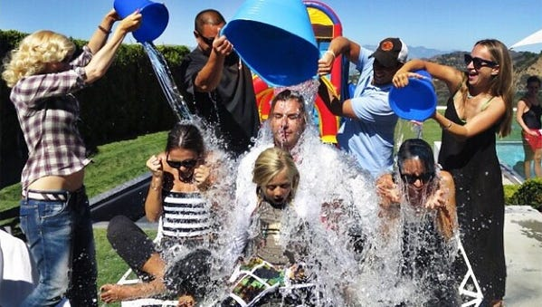 Ice Bucket Challenge: In July and August, everyone seemed to be jumping on the bandwagon by dumping a bucket filled with ice water over their heads, filming it and putting the video on YouTube. Silly, sure, but it raised awareness for amyotrophic lateral sclerosis, or Lou Gehrig's disease, as people challenged others to donate or douse themselves. It suceeded in bringing in dollars, too, with the ALS Association gathering $41.8 million in donations between July 29 and Aug. 21. It probably would be quicker to name the celebs who didn't participate, because public figures from George W. Bush to Justin Bieber joined in. Nicole Richie and Gavin Rossdale, Gwen Stefani and Jessica Alba completing the ALS Ice Bucket Challenge (pictured).