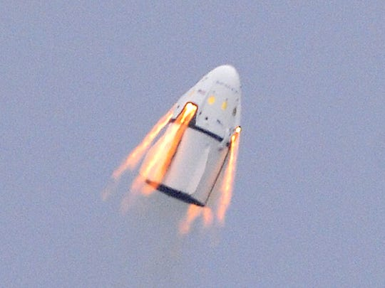 The SpaceX Dragon crew capsule and trunk blasts into the air during a Pad Abort Test at Cape Canaveral Air Force Station.