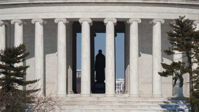 The Jefferson Memorial monument is seen with the statue of Thomas Jefferson in the center, and the White House to the rear on February  12, 2010 in Washington, DC. AFP Photo/Paul J. RICHARDS (Photo credit should read PAUL J. RICHARDS/AFP/Getty Images)
