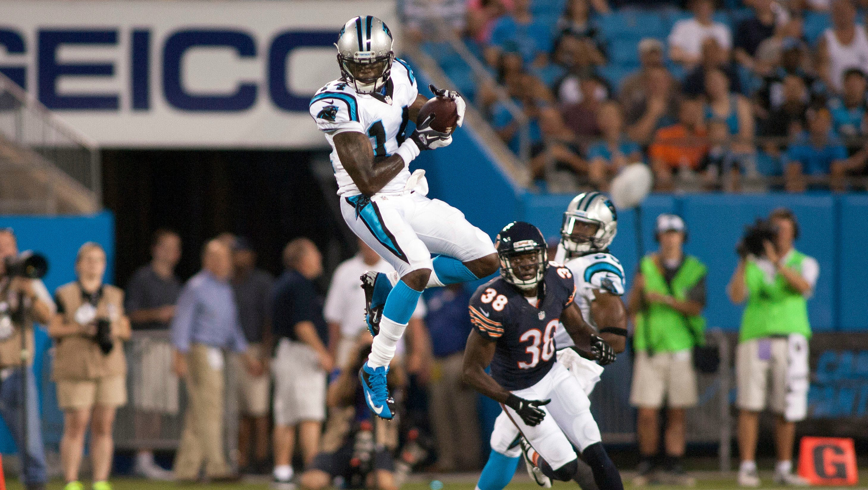 Carolina Panthers wide receiver Armanti Edwards (14) jumps up to catch a pass against the Chicago Bears during the first quarter.