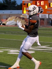 Burkburnett's Carrington Manuel catches a pass against