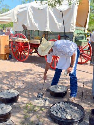 Cooking up meals at the Farm & Ranch chuckwagon.