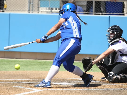 Angelo State's Karina Rocha takes a swing in a Lone Star Conference softball doubleheader against Tarleton State at Mayer Field on Friday, March 30, 2018.