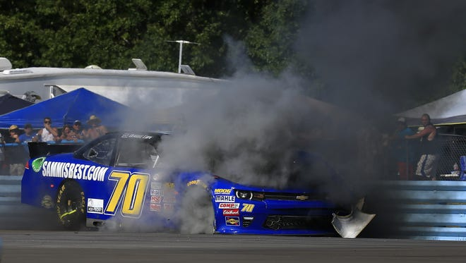 Smoke envelopes the No. 70 Chevrolet driven by Derrike Cope after an on-track incident during the Zippo 200 at Watkins Glen International.