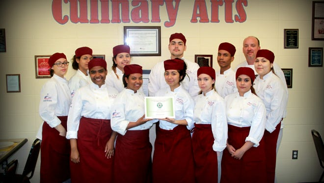 "Culinary arts student of the Perth Amboy Campus of the Middlesex County Vocational and Technical Schools worked to achieve ""Green Restaurant"" certification. Front row, from left are Vida Ramirez, Gabriella Gonzalez, Amy Ramirez, Jaliza Rosario, Alison Rojas. Back row, from left, Lisbeth Servage, Angeline Rodriguez, Soledad Ortega, Nicholas Merced, Enmanual Herrera, instructor Stephen J. Moir, Jenifer Alvarado."